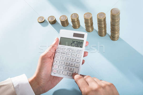 Person Calculating Savings On Calculator Stock photo © AndreyPopov