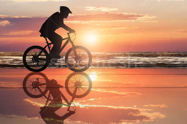 Silhouette Of A Cyclist At Beach Stock photo © AndreyPopov