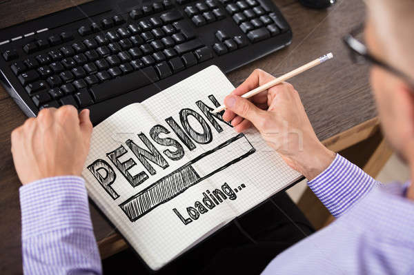 Businessperson Drawing Pension Concept On Notebook Stock photo © AndreyPopov