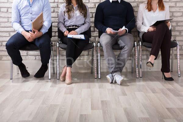 Espera primer plano gente de negocios sesión silla Foto stock © AndreyPopov