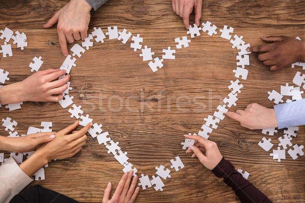üzletemberek szív alak kirakós játék magasról fotózva kilátás felirat Stock fotó © AndreyPopov
