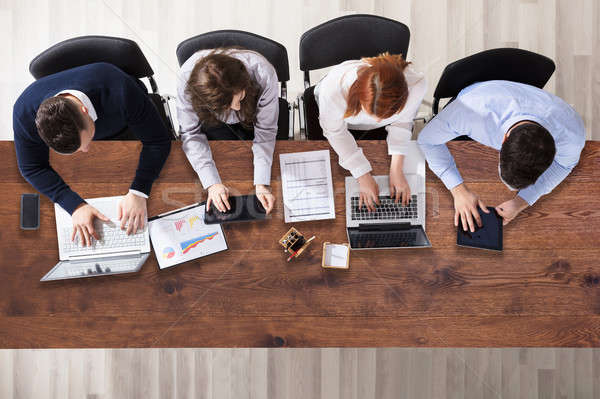 Stock photo: Group Of Businesspeople Working In Office
