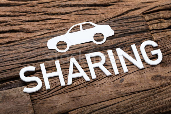 Paper Car And Sharing Text On Wooden Table Stock photo © AndreyPopov