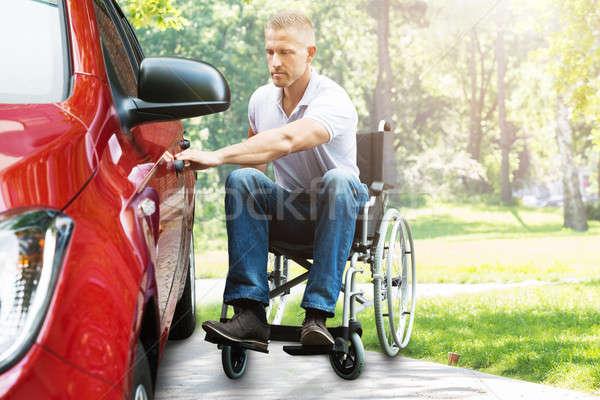 Сток-фото: человека · коляске · открытие · автомобилей · двери · молодым · человеком