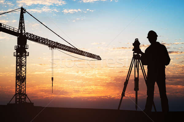 Surveyor Standing With Equipment At Construction Site Stock photo © AndreyPopov