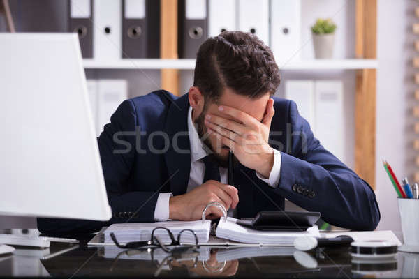 Man Suffering From Headache Working In Office Stock photo © AndreyPopov