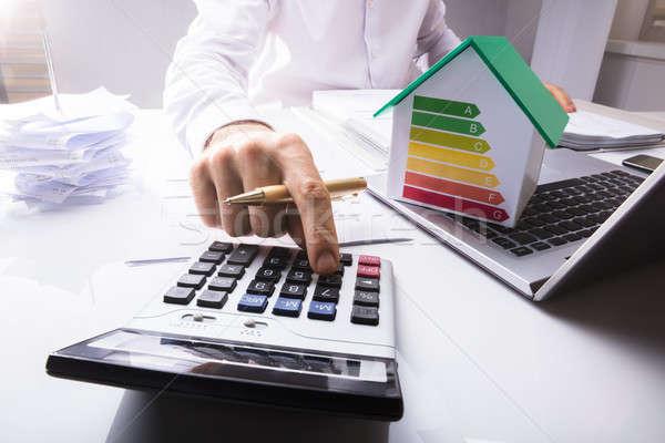 Businessman Calculating Financial Data Stock photo © AndreyPopov