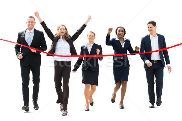 Businesspeople Running Towards Red Ribbon Stock photo © AndreyPopov
