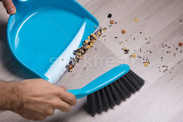 Man Sweeping The Dirty Floor Stock photo © AndreyPopov
