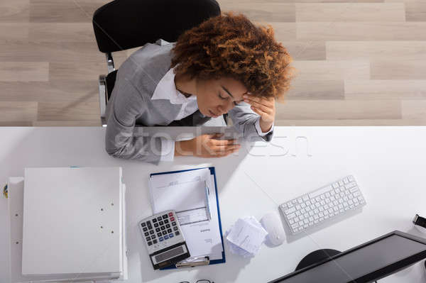 Unhappy Afro American Businesswoman Sitting In Office Stock photo © AndreyPopov
