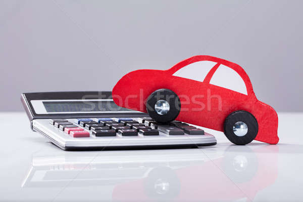 Close-up Of Red Car And Calculator Stock photo © AndreyPopov