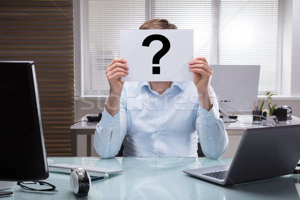 Businessperson Holding Placard With Question Mark Sign Stock photo © AndreyPopov