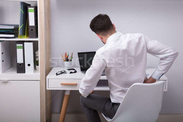 Empresário sofrimento dor nas costas local de trabalho escritório Foto stock © AndreyPopov