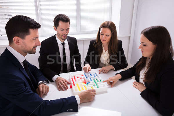 Businesspeople Holding Multi Colored Arrow Solving Maze Stock photo © AndreyPopov