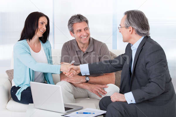 Consultant Shaking Hand With Woman Stock photo © AndreyPopov