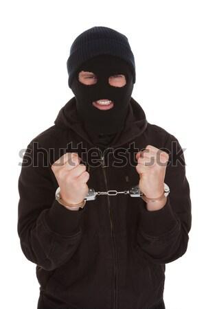 Bűnöző zárolt bilincs mérges fehér kezek Stock fotó © AndreyPopov