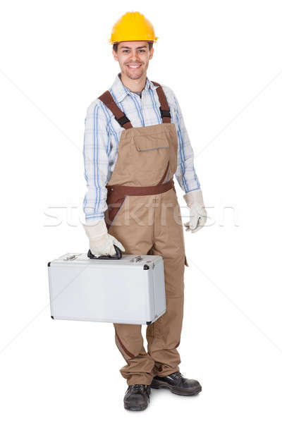 Workman carrying a toolkit Stock photo © AndreyPopov