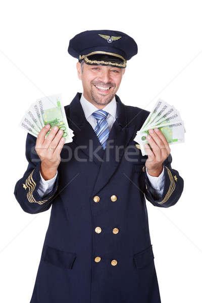 Portré boldog pilóta tart eurók fehér Stock fotó © AndreyPopov