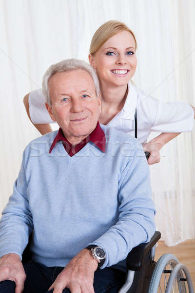 Caring Doctor Helping Handicapped Patient Stock photo © AndreyPopov