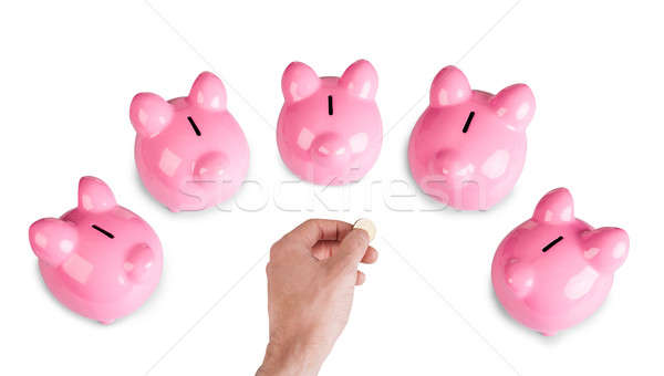 Hand with coin and five piggybanks Stock photo © AndreyPopov