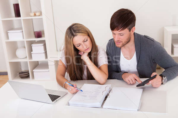 Unhappy young couple in financial trouble Stock photo © AndreyPopov