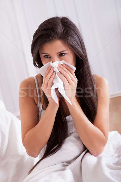 Woman ill in bed with a cold and flu Stock photo © AndreyPopov