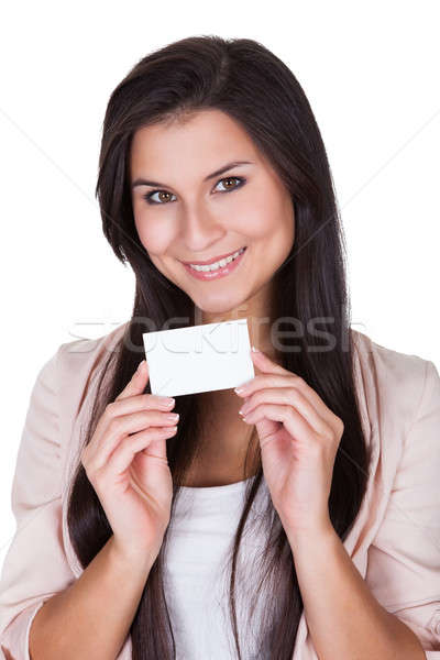Attractive brunette with business card Stock photo © AndreyPopov