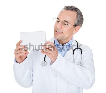 Doctor holding prescription note Stock photo © AndreyPopov