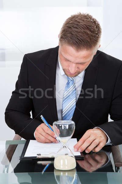 Businessman under time pressure Stock photo © AndreyPopov