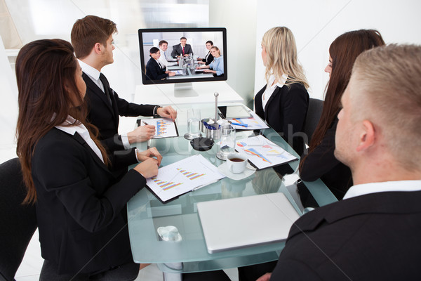 Businesspeople Attending Video Conference Stock photo © AndreyPopov