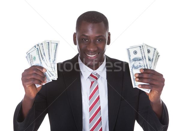 üzletember tart bankjegyek portré fiatal fehér Stock fotó © AndreyPopov
