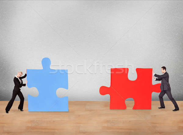 Business People Joining Puzzle Pieces On Desk Stock photo © AndreyPopov