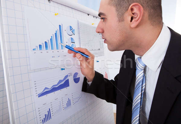 Businessman Analyzing Graph With Pen Stock photo © AndreyPopov