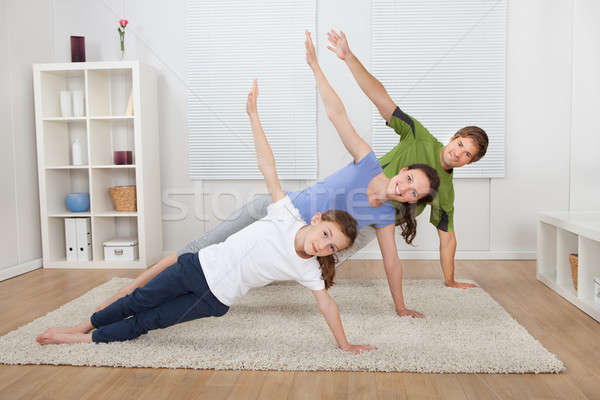 Fit Family Doing Side Plank Yoga At Home Stock photo © AndreyPopov