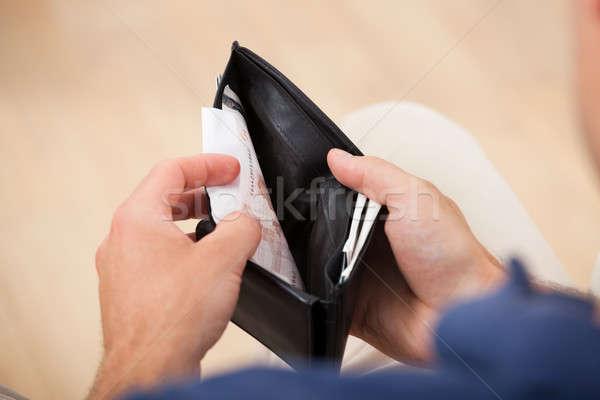 Broke Man Holding Wallet Stock photo © AndreyPopov