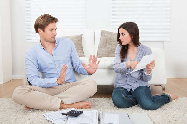 Woman Blaming Man For Excessive Expenses At Home Stock photo © AndreyPopov