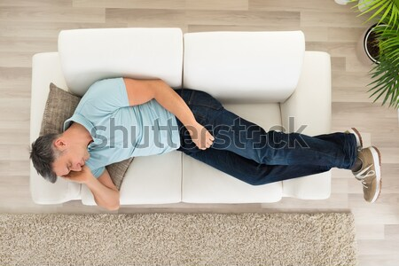 Stock photo: Woman Suffering From Stomachache On Sofa