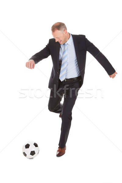 Businessman Kicking Soccer Ball Stock photo © AndreyPopov