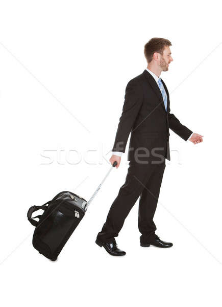 Businessman With Luggage Walking Over White Background Stock photo © AndreyPopov