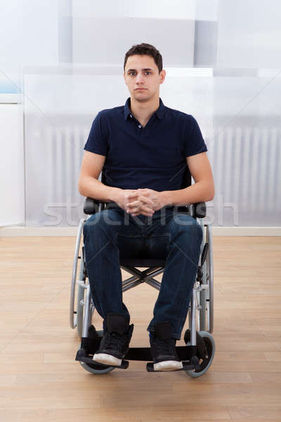 Handicapped Man Sitting On Wheelchair At Home Stock photo © AndreyPopov
