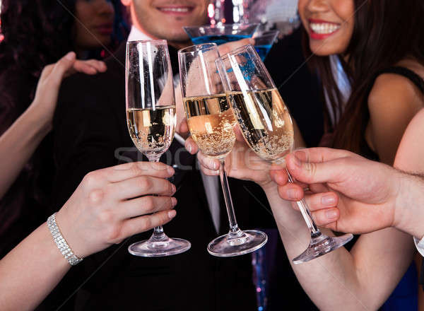 Friends Toasting Champagne At Nightclub Stock photo © AndreyPopov