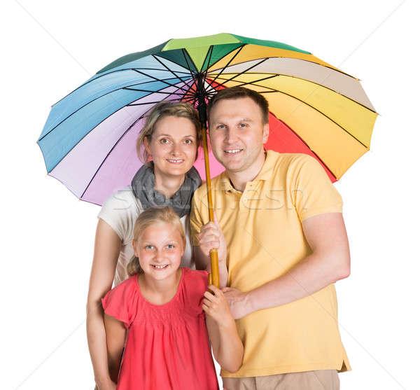 Biztosított család áll esernyő izolált fehér Stock fotó © AndreyPopov
