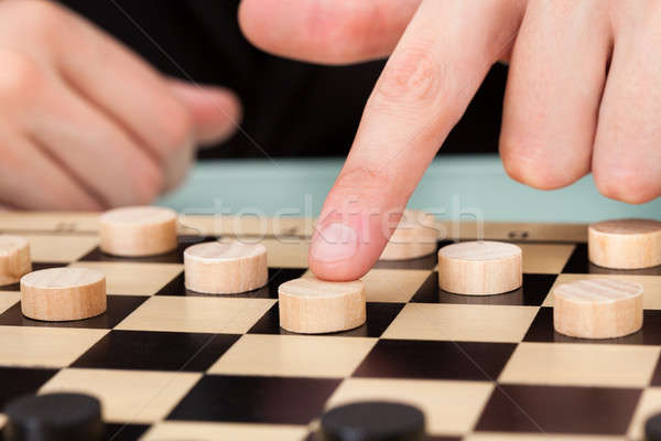 Businessman Playing Checkers Stock photo © AndreyPopov