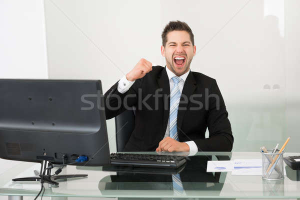 Successful Businessman Screaming At Desk Stock photo © AndreyPopov