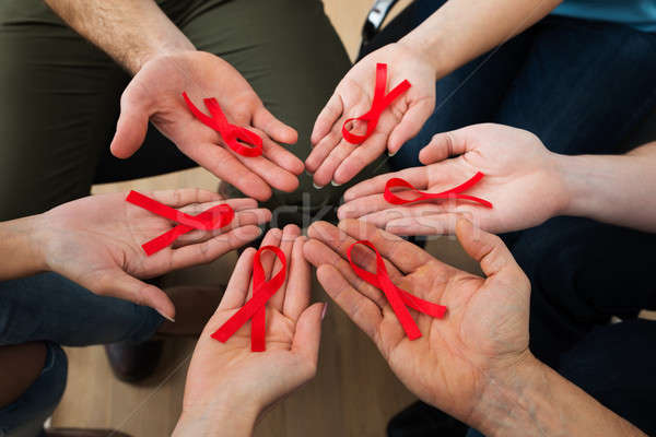 People Holding Aids Ribbon Stock photo © AndreyPopov