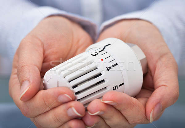 Hand With Valve Of Heating System Stock photo © AndreyPopov