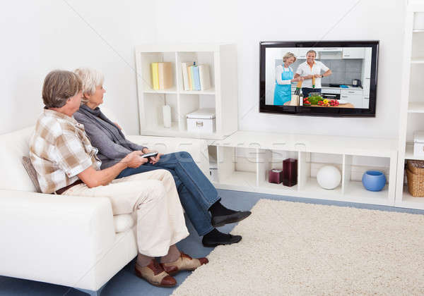 Senior Couple Watching Television Stock photo © AndreyPopov