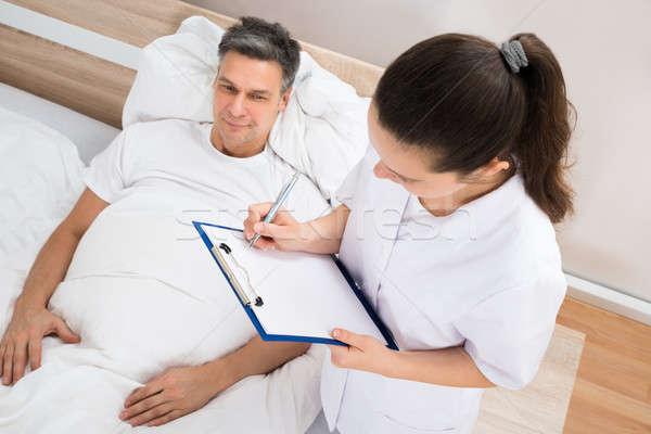 Doktor reçete hasta kadın yazı Stok fotoğraf © AndreyPopov