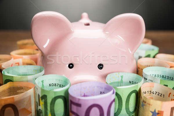 Persely Euro bankjegyek közelkép tekert üzlet Stock fotó © AndreyPopov