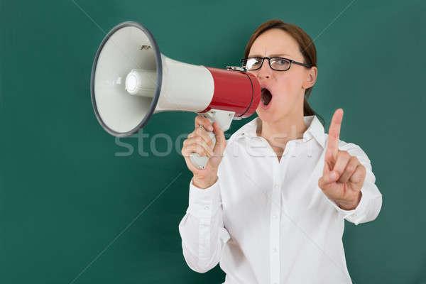 Empresária megafone jovem quadro-negro negócio Foto stock © AndreyPopov